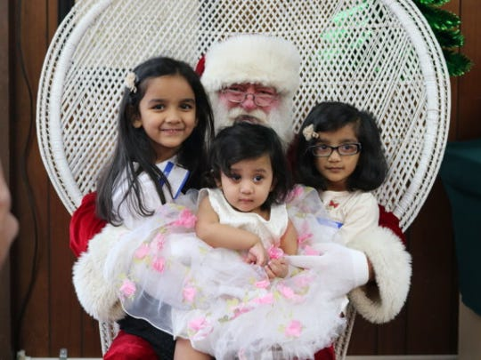 Mahi, Viha and Ruhi Parekh told Santa what they want for Christmas at the Bull Shoals Hoevel-Barnett VFW Post 1341 children's Christmas party. Santa's reindeer were resting up for the big Christmas Eve flight, so Santa arrived in a Bull Shoals fire truck with a police escort. Those attending the party were served lunch and cookies. The children played games, got temporary tattoos and won prizes. Santa listened to each child's Christmas wish and gave each a gift and a bag of candy. Many thanks to Santa and all the volunteers that made the party fun for all those attending.