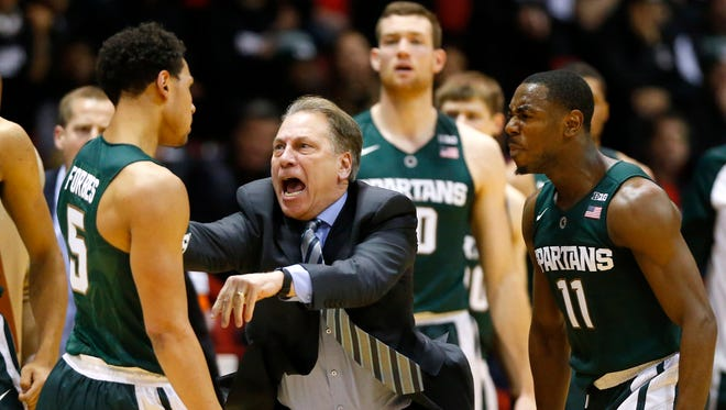 "After a hustle play by Bryn Forbes forced a Northeastern turnover in the first half, Tom Izzo shouts, ""Way to go!"" at Forbes."