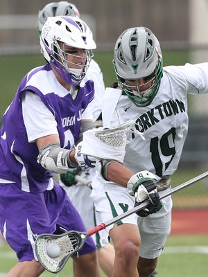 Brett Makar cames up with a turnover, helping Yorktown come from behind to defeat John Jay 11-10 in boys lacrosse action at Yorktown High School April 15,  2017.