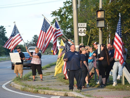 A crowd of about 50 people gathered at the corner of