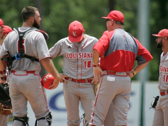 Ragin' Cajuns' pitcher Evan Guillory, center, holds