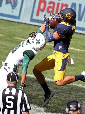 Moorpark High graduate Chad Hansen, right, catching a touchdown pass against Hawaii last year for Cal, was picked by the New York Jets in the fourth round of the NFL Draft on Saturday.
