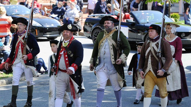 A re-enactment group marches in the parade at the Dover Days Festival on Saturday.