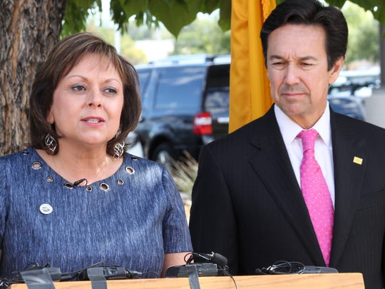 New Mexico Gov. Susana Martinez is joined by outgoing Economic Development Secretary Jon Barela as she talks about Facebook's decision to locate a data center in the state during a news conference in Los Lunas, N.M., on Thursday, Sept. 15, 2016. Martinez said New Mexico would not have been on the radar of the social media giant had it not been for a meeting she had with executives in August 2015.
