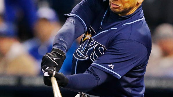 Tampa Bay Rays' James Loney hits an RBI double off Kansas City Royals relief pitcher Greg Holland during the ninth inning of a baseball game at Kauffman Stadium in Kansas City, Mo., Tuesday, April 8, 2014. The Tampa Bay Rays defeated the Royals 1-0. (AP Photo/Orlin Wagner)