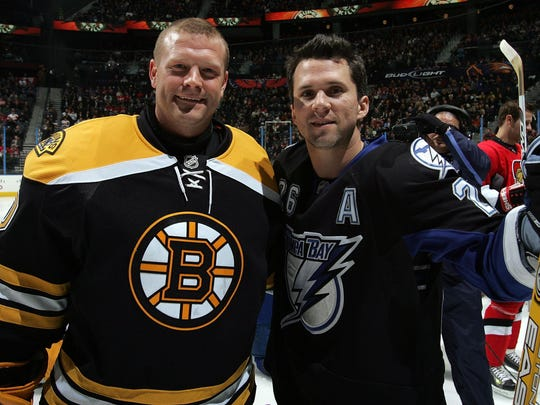 Former University of Vermont hockey stars Tim Thomas, left, and Martin St. Louis pose for a photo during the 2008 NHL All-Star weekend.