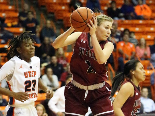New Mexico State's Brooke Salas grabs a defensive rebound against UTEP Thursday night in the Don Haskins Center in El Paso.