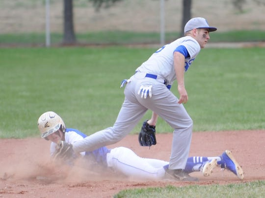 Chillicothe's Jason Benson tags a runner out sliding into second base during Friday's contest against Washington High School.