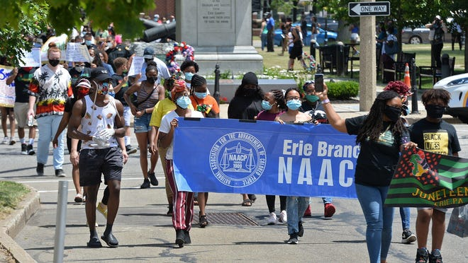 About 175 people march from Perry Square toward the Erie County Courthouse following a Juneteenth rally on June 19. The event was meant to call for an end to police brutality and concluded with a nine-minute kneeldown at the Erie County Courthouse.