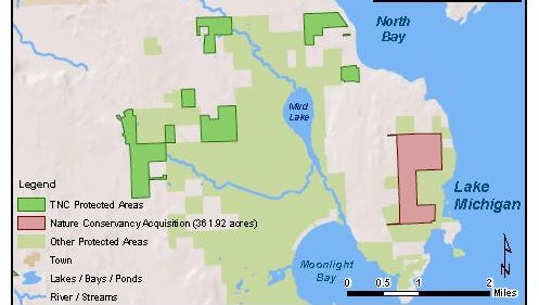 The recent Nature Conservancy land purchase is highlighted in pink.