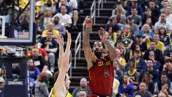 Cleveland Cavaliers' JR Smith sinks a basket from long
