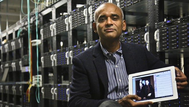 Chet Kanojia, founder and CEO of Aereo, Inc., shows a tablet displaying his company's technology in New York on Dec. 20, 2012.