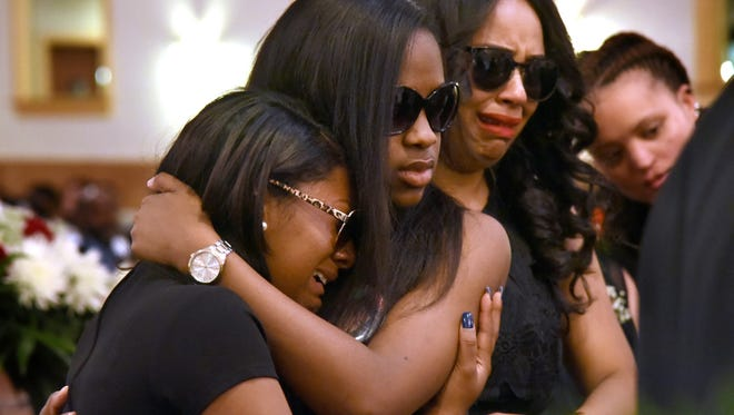 (From left) Cousin India Bush, sister Destinee Carmichael, girlfriend Aariona Johnson and cousin Monica Robinson grieve Saturday at the funeral for Camden shooting victim Terron Phillips Jr.