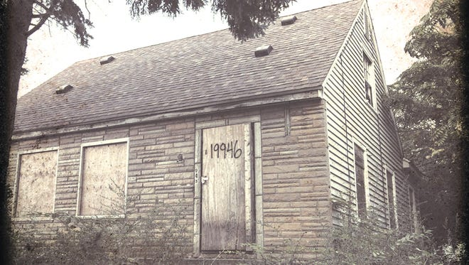 """This CD cover image released by Aftermath shows """"The Marshall Mathers LP2,"""" by Eminem."""