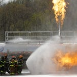 Federal statistics show that stress and overexertion are the leading causes of deaths among on-duty firefighters. In this 2014 photo, firefighters in Albany practice battling crude oil fires.