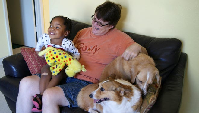 Anne Hillman and her daughter, Jada Buck, with their dogs Lilly and Hazel at Family Promise in Scottsdale on Oct. 10, 2014.
