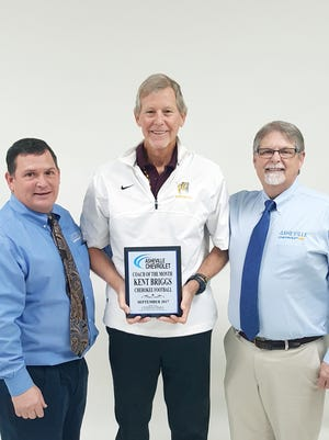 Cherokee football coach Kent Briggs, center, is the Asheville Chevrolet Coach of the Month.