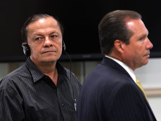 Fabio Aristizabal, l, and defense attorney Walter Laufenberg on the first day of trial. Aristizabal is charged with vehicular homicide, allegedly driving under the influence of alcohol when he struck and killed Richard Oberst, 64, of Morris Plains on Dec. 22, 2012. September 29, 2015, Morristown, NJ.
