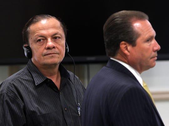 Fabio Aristizabal, l, and defense attorney Walter Laufenberg