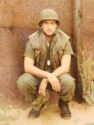 Mitchell Barnett as he served in Vietnam. Barnett was
