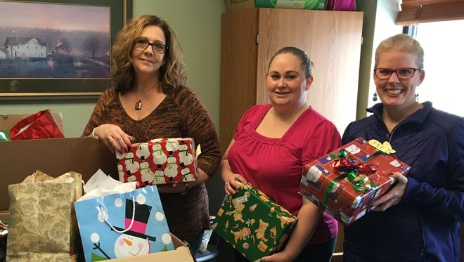 Big Brothers Big Sisters is looking for businesses, families, clubs, organizations or individuals that would like to adopt a family during the holiday season. Pictured, are, from left: Joanne Schneider, Mid-States Aluminum; Jennifer Smith, BBBS; and Tammy Young, BBBS.