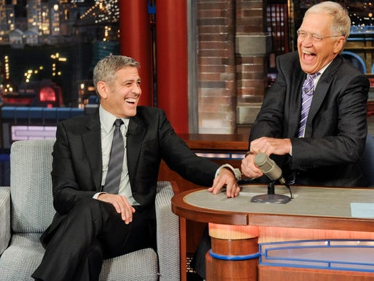 In this photo provided by CBS, actor George Clooney,
