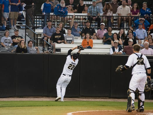 Pitcher Kyle Marsh catches a foul ball against No.