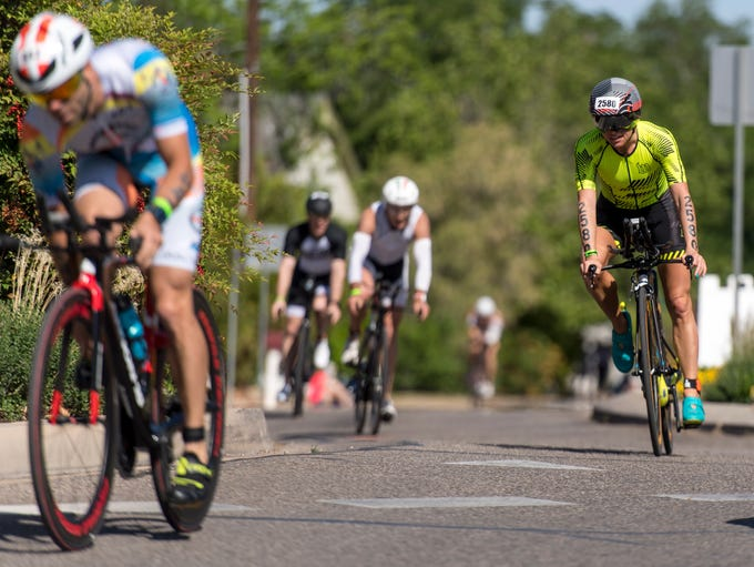 Athletes compete in the St. George Ironman competition