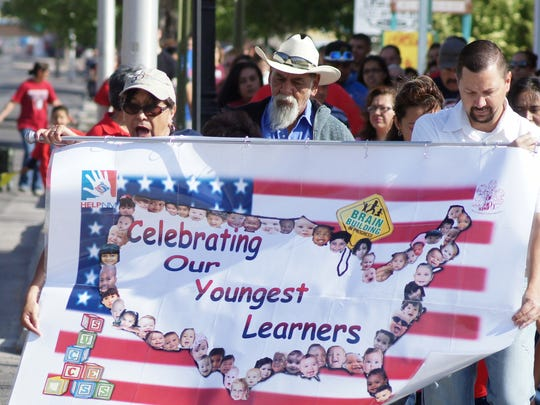 "Children and their families stretched along South Gold St. on Friday during the Day of the Young Child March. This year's theme was ""Celebrating Our Youngest Learners."""