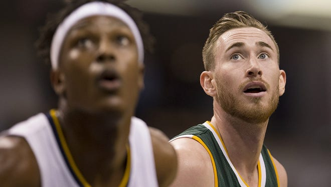 Former Butler University great Gordon Hayward (right), looks for a rebound during first half action for Utah Jazz at Indiana Pacers, Bankers Life Fieldhouse, Indianapolis, Monday, March 20, 2017.