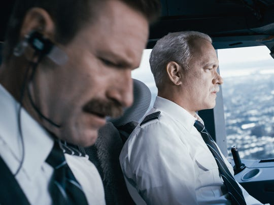 Tom Hanks (right) is Sully Sullenberger and Aaron Eckhart (left) is co-pilot Jeff Skiles in 'Sully.'