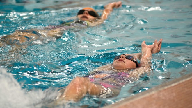 Jill Brown (bottom) and Morgan McNabb practice their backstroke at practice on Wednesday, Aug. 17, 2016 at Marine City High School.