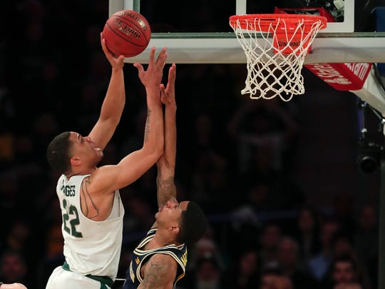 Miles Bridges puts up a shot after a post move in the second half Saturday against Michigan.