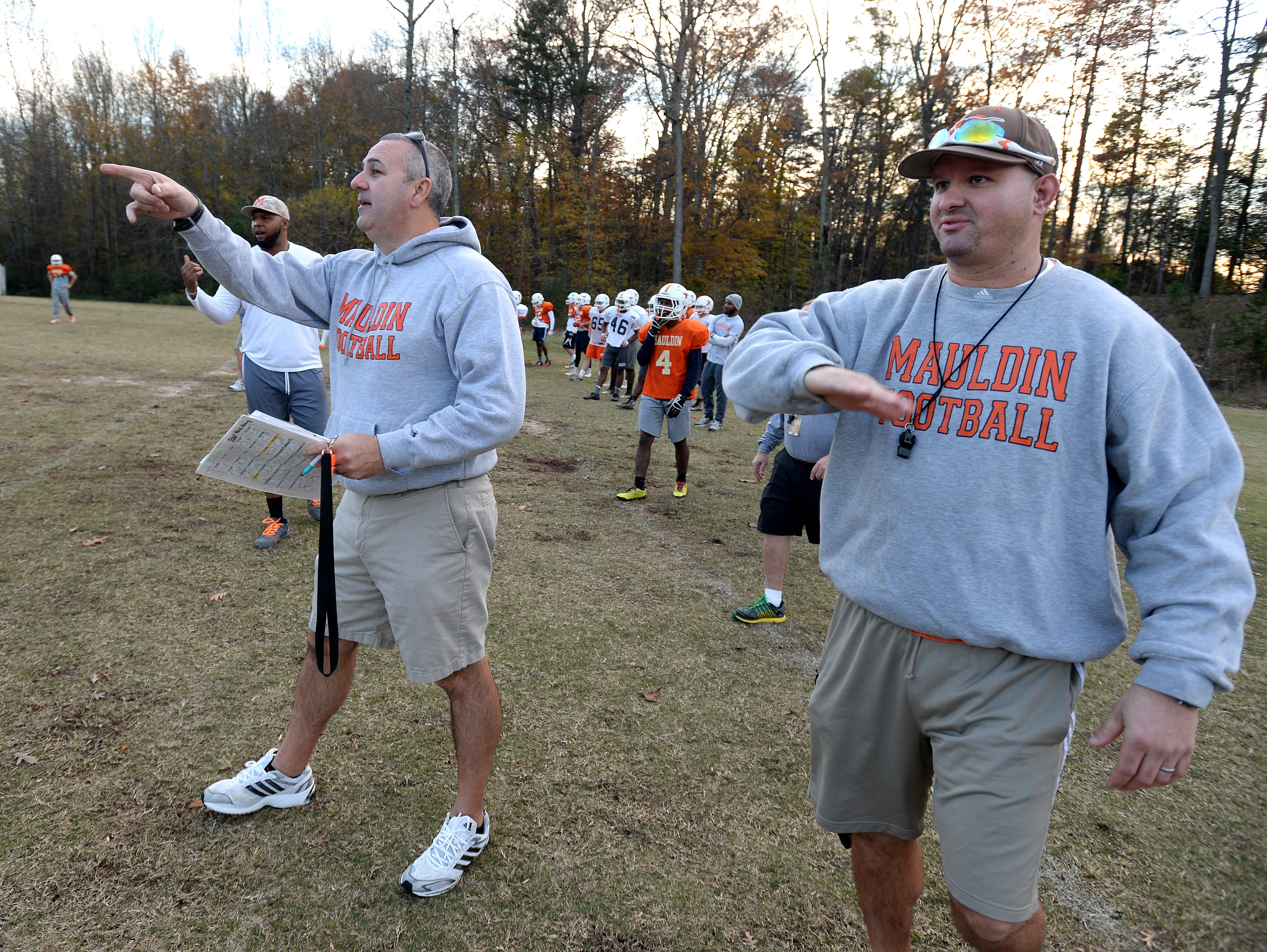 Mauldin head coach Lee Taylor, left, and assistant coach Brian Thompson call plays to the offense during the teams practice Monday, November 16, 2015. Mauldin will play Hillcrest in the 1st round of the AAAA playoffs Friday at Hillcrest.