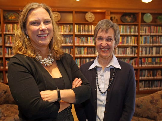 From left, Beth Bermel, library director and Terri