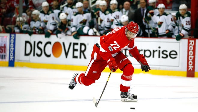 Andreas Athanasiou heads up ice before scoring on a breakaway to clinch the Red Wings' 3-2 win in overtime against the Minnesota Wild at Joe Louis Arena on March 26, 2017.