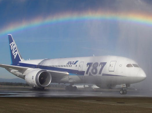 A ANA Boeing 787 taxis under a rainbow created by a water salute at Seattle-Tacoma International Airport on Oct. 1, 2012, during an official welcome ceremony for the jet.