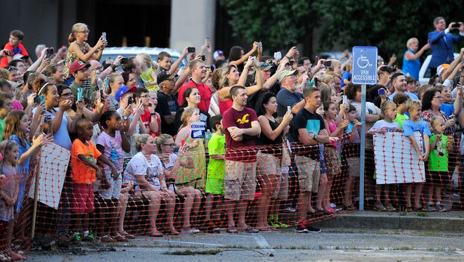 Spectators watch a demolition of an entrance of Bellevue Center in Bellevue, on Saturday, Aug. 22, 2015. This is the first step to making One Bellevue Place on the property.