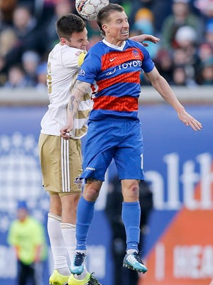 FC Cincinnati midfielder Corben Bone (19) jumper for a header during the first half of the USL soccer match between FC Cincinnati and Louisville City FC at Nippert Stadium in Cincinnati on Saturday, April 7, 2018. At halftime Louisville led 1-0.
