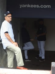 Former manager Joe Torre on the steps of the Yankee