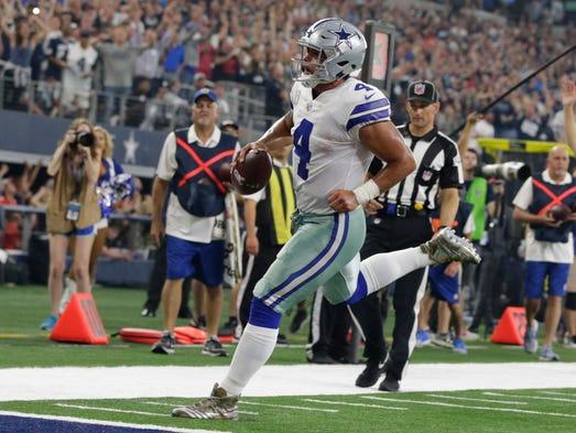 Dallas Cowboys quarterback Dak Prescott runs for a