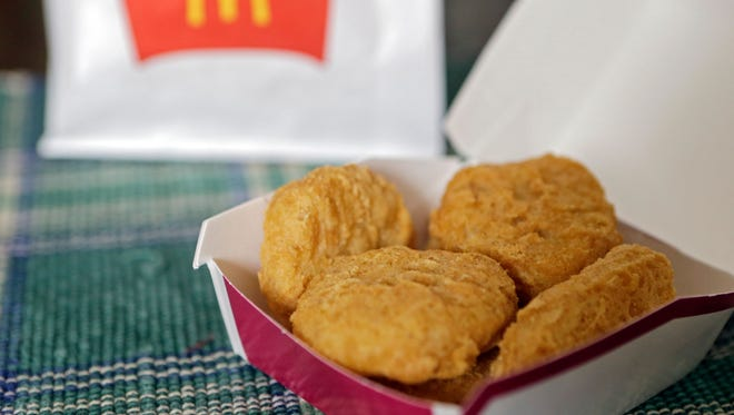 Two women crawled through an Indianapolis  McDonald's drive-thru window in a dispute over their McNuggets order Nov. 10.