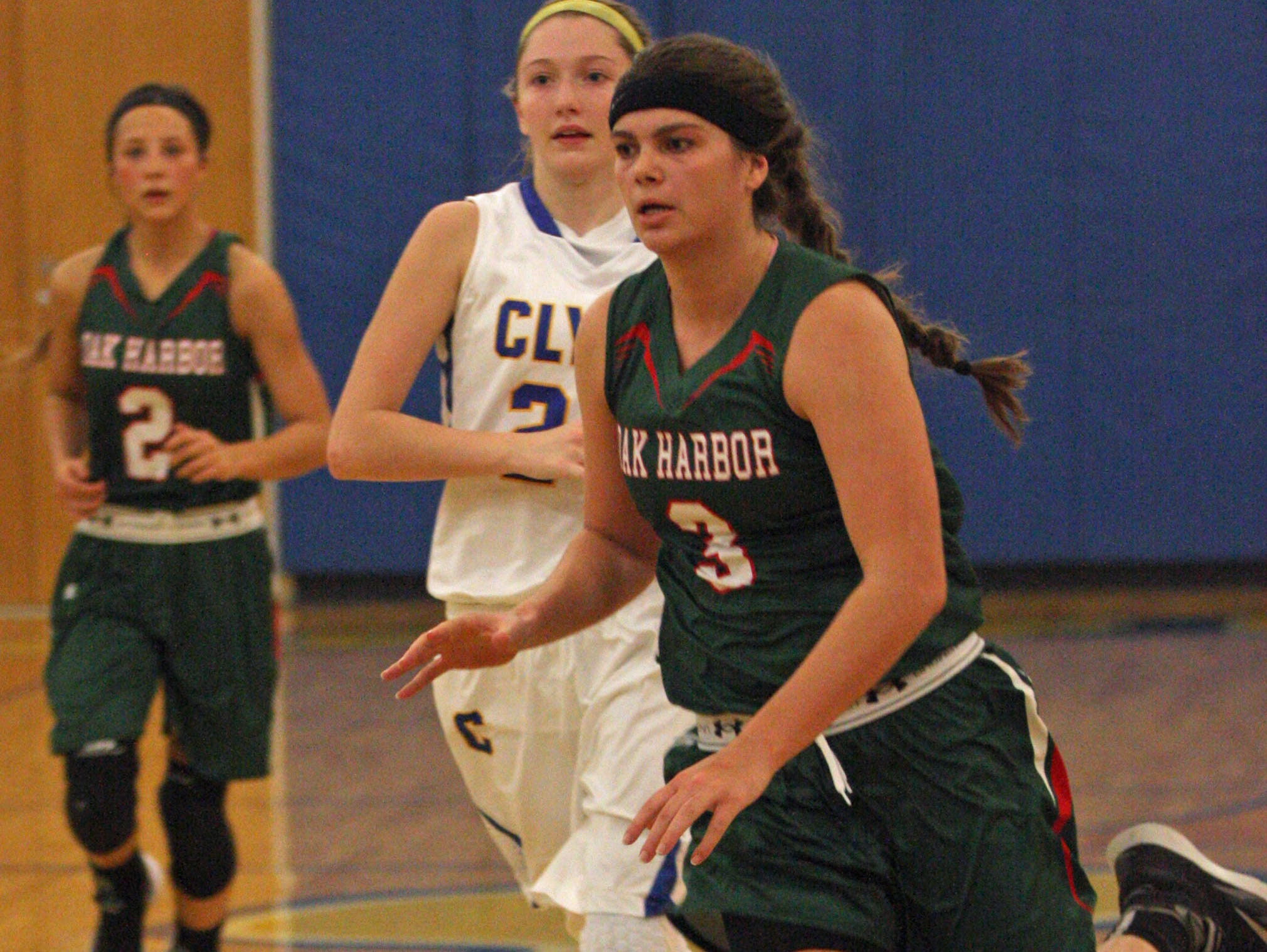 Oak Harbor's Andrea Cecil leads the break Saturday against Clyde.