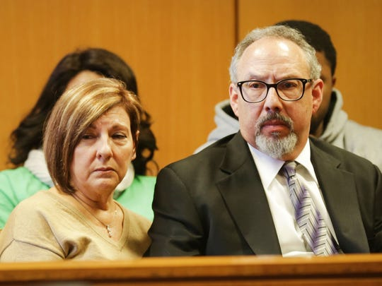 Scott Monchnik, right, sits in the courtroom.