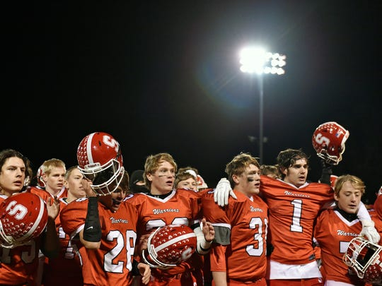 Susquehannock football players sing the alma mater after playing a PIAA District 3 first-round game Friday, Nov. 10, 2017, at Susquehannock. Susquehannock lost 45-14 to East Pennsboro in the Warriors' first playoff appearance since 2006, ending their first winning season since 2007.