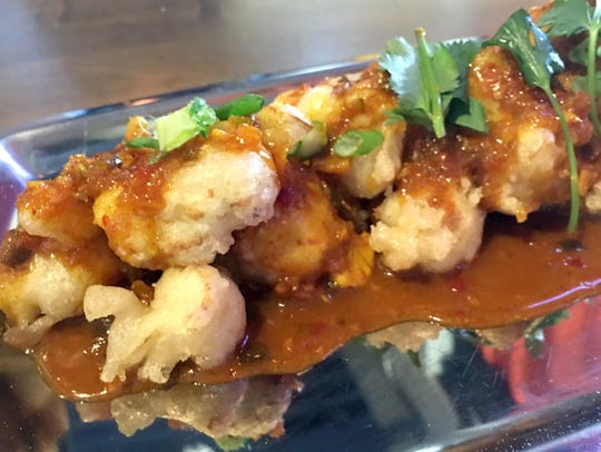 Curry Fried Cauliflower is served atop a Manchurian
