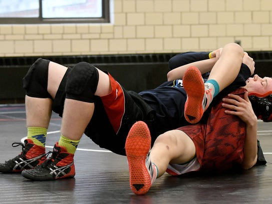 Logan Knipp drills with a teammate in preparation for