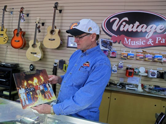 "Roy Beard, owner of Vintage Music & Pawn in St. George, shows a signed, original pressing of Lynyrd Skynyrd's 1977 album ""Street Survivors,"" which released only three days before three of the band members were killed in a plane crash. Future versions of the album featured a different cover without the flames because of that tragedy."