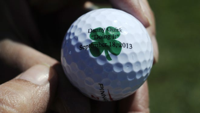 All of the golf balls were customized with Danny Quirk's motto at Wednesday's golf outing held in his memory.