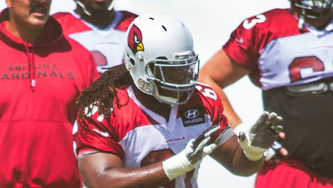 Arizona Cardinals offensive lineman Jonathan Cooper lifts his hands to block during practice at the training facility on Monday, August 25, 2014, in Tempe,.